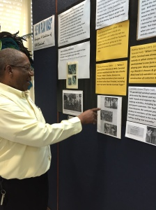 "PVC Dale Webber checking out some of the historic images from UWI Carnival, during a visit to the exhibition: ""Le' Wi Play Mas!"""